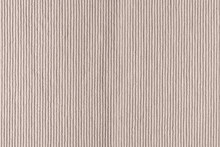 Dense Woven Ribbed Texture. Upholstery Fabric Close Up. Empty Light Beige Background For Layouts.