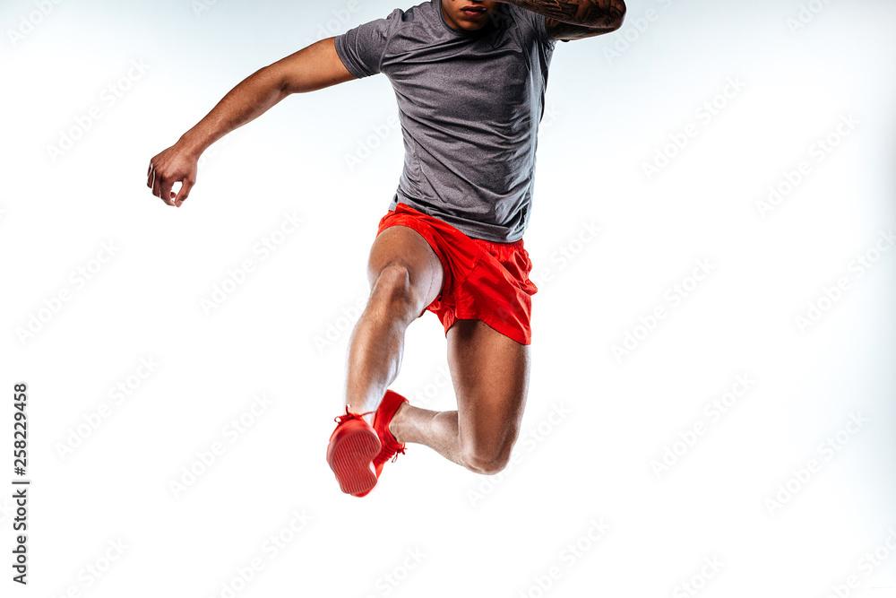 Fototapety, obrazy: Jumping man wearing stylish and comfortable sportswear