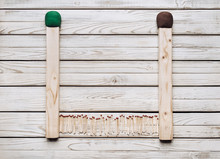 Two Big Matches And Many Small Ones On A Wooden Background. Concept Of Dwarf And Giant. Fire Safety.