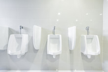 Public Toilet Urinals Lined Up, No Privacy.