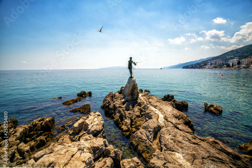 Poster Cote The historic statue of Maiden with the seagull is a symbol, not only of Opatija, but the entire Kvarner region. The statue on Adriatic coast is in the touristic town of Opatija in Croatia, Europe