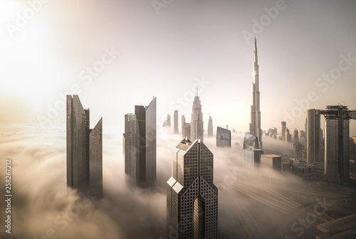 Cadres-photo bureau Dubai Cityscape of Dubai Downtown skyline on a foggy winter day. Dubai, UAE.