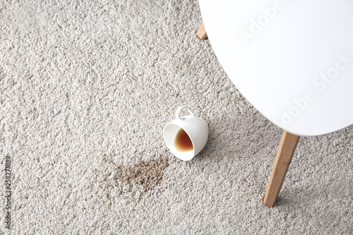 Cup of coffee spilled on carpet Tablou Canvas