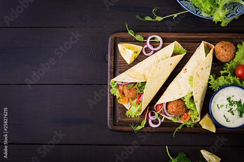 Tortilla wrap with falafel and fresh salad Canvas Print