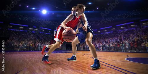 Carta da parati Basketball player n action. around Arena with blue light spot