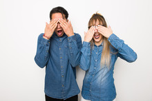 Young Couple With Glasses Covering Eyes By Hands. Surprised To See What Is Ahead