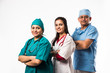 Indian/asian male surgeon and doctor/ medical practitioner standing together, isolated over white background