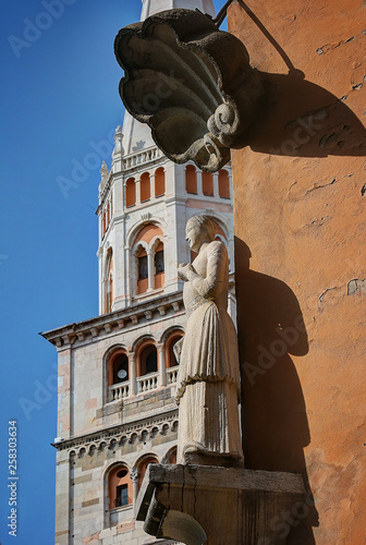 Photo  Modena, Emilia Romagna, Italy, Ghirlandina tower and Bonissima statue, Unesco wo
