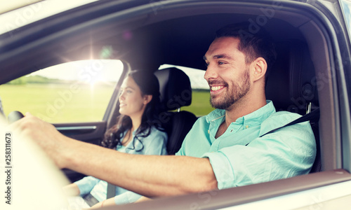 leisure, road trip, travel, family and people concept - happy man and woman driv Fototapet