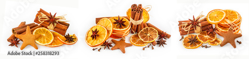 Fototapeta Set of dried oranges, star anise, cinnamon sticks and gingerbread, isolated on white background obraz
