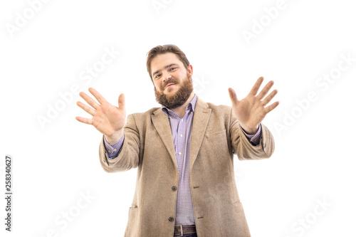 Obraz na plátně  Portrait of funny big handsome smiling bearded business man in beige suit, isola