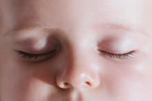 Close Up View Of Baby Sleeping. Eyes Closed And Resting. Baby And Family Concept.