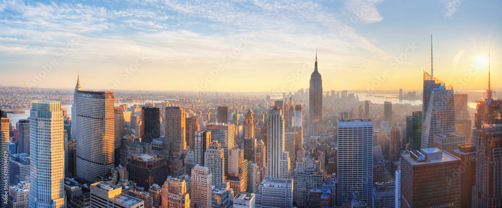 Obraz Panoramic panoramic view of Empire State Building and Manhatten skyline at sunset new york city new york usa  fototapeta, plakat