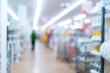 abstract blur image background of shelf product in mall with shopping people customer