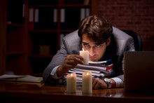 Businessman Working Late In Of...
