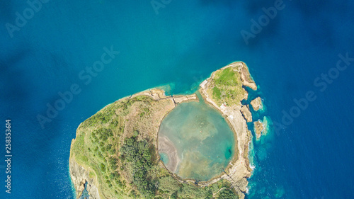 Montage in der Fensternische Olivgrun Top view of Islet of Vila Franca do Campo is formed by the crater of an old underwater volcano near San Miguel island, Azores, Portugal. Bird eye view, aerial panoramic view.