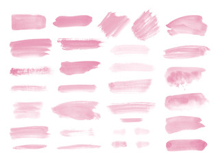 Watercolor brush strokes and splashes isolated on white background. Pink background blobs. Hand drawn painted design elements.
