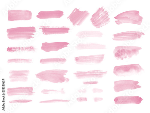 Valokuva  Watercolor brush strokes and splashes isolated on white background
