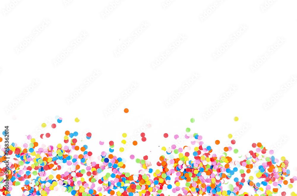 Fototapeta Colorful assorted confetti with serpentine on white