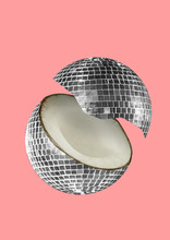 A Paradox. An Alternative Coconut Or Musicial Nut As A Silver Bright Discoball Against Trendy Light Coral Background. Negative Space To Insert Your Text. Modern Design. Contemporary Art Collage.