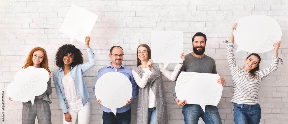 Fototapeta Group of millennial people holding empty speech bubbles