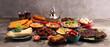 Leinwanddruck Bild - Middle eastern or arabic dishes and assorted meze, concrete rustic background. Falafel. Turkish Dessert Baklava with pistachio. Halal food. Lebanese cuisine