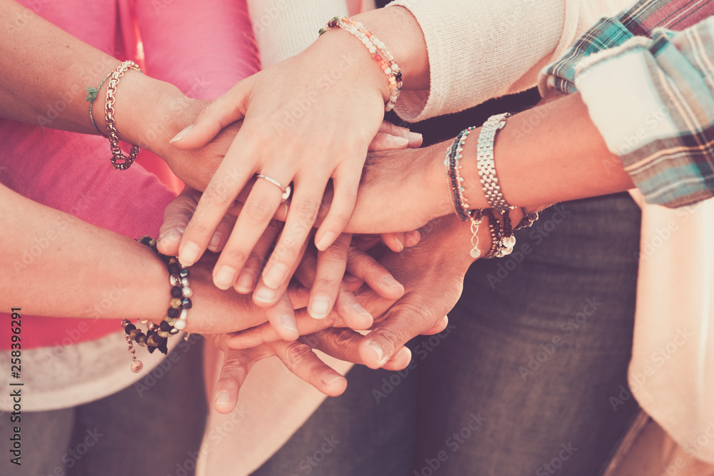 Fototapeta Teamwork and friendship together concept with hands put on hands - women power day for work and friends - caucasian people team in vintage filter colors