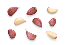 A Collection Of Garlic Cloves Isolated On A White Background.