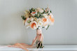 Bridal bouquet. Beautiful blooming bouquet of pastel pink roses with a ribbon