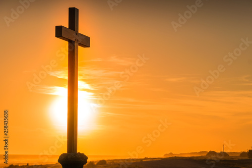 Fotografie, Obraz  Image of cross with sun at sunset