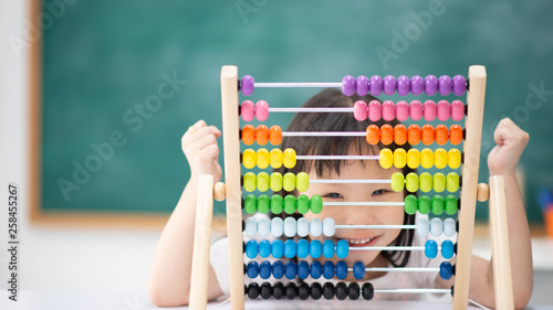 Obraz Students boy and girl leaning math in the class room Montessori - fototapety do salonu