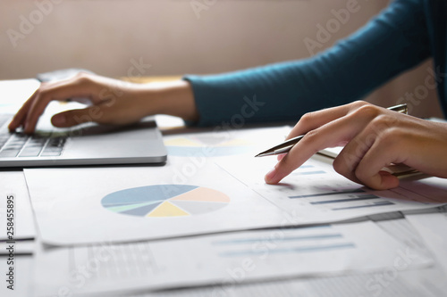 accountant woman working on desk business finance and accounting Wallpaper Mural