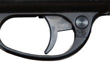 Gun Safety Catch. Pressing The Button To Safe Position. White Background.