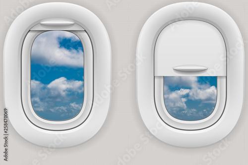 Tuinposter Vliegtuig Fenster im Flugzeug mit Blick in die Wolken