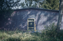 Abandoned Summer Campsite Violet Building With Yellow Door Frame