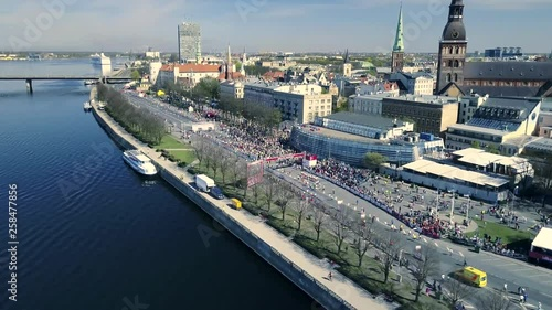 Valokuva  Aerial view from drone on crowd of people who is running on marathon event