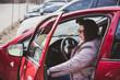 Mature woman car driver, outdoor portrait, automobile and lady