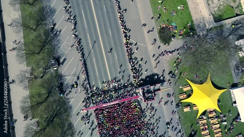 Valokuva  Aerial view from drone on crowd of people who is starting their run on marathon event