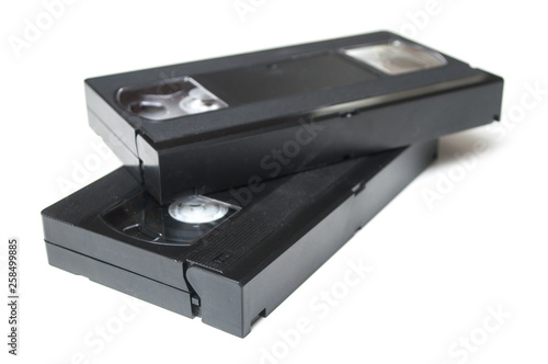 Fotografering  Closeup of vintage VHS Cassettes on white background