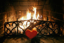 Heart In Front Of The Fireplace. The Fire. Love