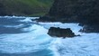 Waves crash against coastline of Maui in the late afternoon
