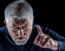 Portrait Of A Senior Man Threateningly Raising His Finger