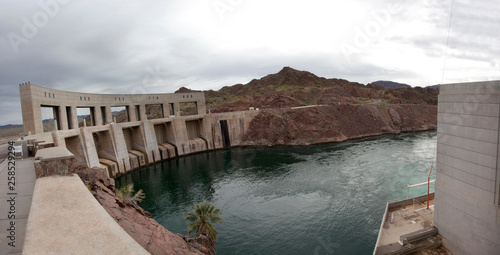 Fotografie, Obraz  Panorama of Parker dam seen from the California side with the Colorado River in the foreground