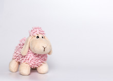 Lamb Plush Toy. White And Pink Lamb. Gray Background.