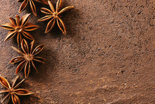 Brown Textured Background With Anise Stars