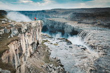 Hiker At Gigantic Dettifoss Waterfall In Iceland