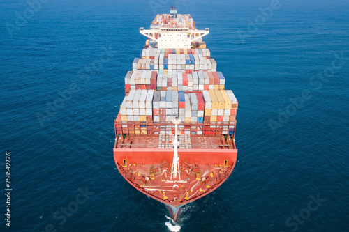 Photo Ultra large container vessel (ULCV 366 Meters long) loaded with various Container brands, at sea - Aerial image