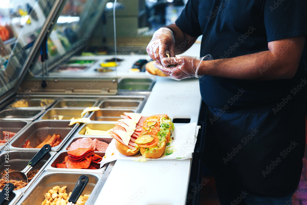 Fototapety, obrazy: preparing sandwich in the restaurant. the kitchen of fast food restaurant