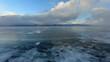 4K. Sunset in the icy Lake Baikal Irkutsk region Russia. Ultra HD