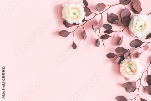 Foto auf Leinwand Indien Flowers composition. Pink flowers and eucalyptus leaves on pastel pink background. Flat lay, top view, copy space